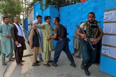 A security force personnel checks a man outside a polling station in Jalalabad on September 28, 2019. - Insurgents worked to disrupt Afghanistan's presidential election on September 28, with a series of blasts reported across the country as voters headed to the polls and troops flooded the streets of the capital. (Photo by Noorullah SHIRZADA / AFP)