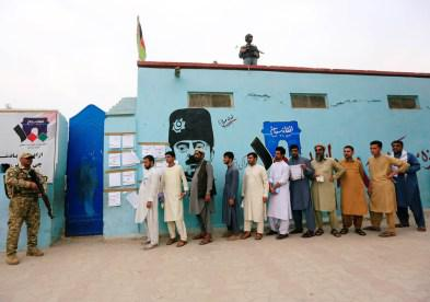 Men arrive to cast their votes outside a polling station in the presidential election in Jalalabad, Afghanistan September 28, 2019. REUTERS/Parwiz - RC14B84880E0